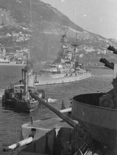 Queen Elizabeth class 15 in battleship HMS Malaya (or conceivably HMS Barham - they were the only members of the class not to receive an updated bridge structure) seen from HMS Rodney at Gibraltar in 1941. Carrier HMS Ark Royal can also be seen in the background. Both Barham and Ark Royal were sunk by U boats that November.