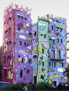 """This bit of architectural awesomeness is the """"Happy Rizzi House"""" located in Braunschweig, Germany. It was created by Pop artist James Rizzi who, we are very sorry to report, passed away on December 26th at the age of 61."""