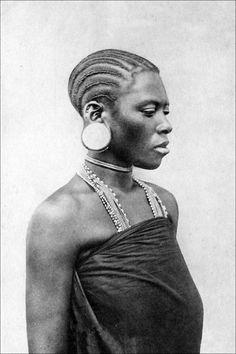 Africa | Swahili woman. Dar-es-Salaam. ca. 1900. | Vintage postcard; photographer A.C. Gomes & Son.