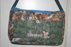 This mom has a passion for hunting and shoes. This bag incorporated both in cotton fabrics. Animals on the outside with leaves pocket and pink shoes on the inside
