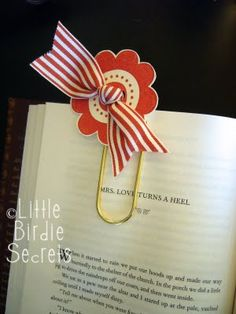 It's a stamped flower tied onto a jumbo paperclip with a piece of wide ribbon. Then we attached it to a flat card and slipped it down in a pocket card to hide the paperclip. Love it!