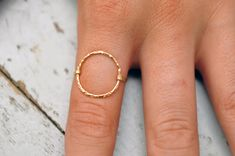 Dainty gold rings.