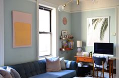 The vintage velvet sofa was a gift from his mom and dad. The painting above the sofa is by Edward Granger.