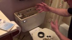 How To Fix a Leaking Toilet Tank - Toilet Tank Repair - Remove Rusted To...