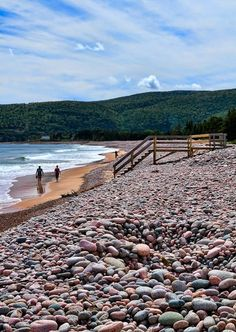 Ingonish Beach, Nova Scotia - Ingonish Beach in the Cape Breton Highlands is covered with round pink stones. Ingonish Beach is the only beach in the Cape Breton Highlands National Park featuring both fresh and salt-water swimming. East Coast Travel, East Coast Road Trip, Places To Travel, Places To See, Nova Scotia Travel, Cabot Trail, Quebec, Cape Breton, Photos Voyages