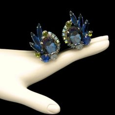 D E Juliana Vintage Large Earrings Bright Blue Green Glass Rhinestones Bridal, $99 from www.myclassicjewelryshop.com. Looking for a pair of striking earrings to dress up your special outfits? These gorgeous vintage clips are just perfect. :)
