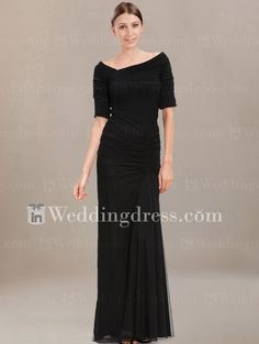 Elegant mother of the bride dress features off-center pleating enhancing the flattering silhouette of a chiffon gown with a wide, asymmetrical neckline.