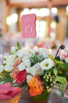 Pretty flowers and a fun coral table number