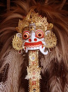 "Rangda is the demon queen of the leyaks in Bali, according to traditional Balinese mythology. Terrifying to behold, the child-eating Rangda leads an army of evil witches against the leader of the forces of good — Barong. The battle between Barong and Rangda is featured in a Barong dance which represents the eternal battle between good and evil.[1] Rangda is a term in old Javanese that means ""widow."""