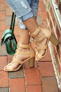 Get strappy with your look by stepping into these T-strap sandals featuring a must-have design for warm-weather months.