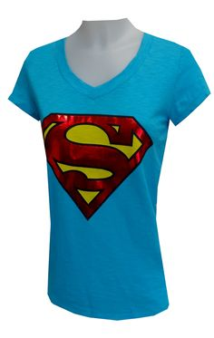 DC Comics Supergirl Tee Shirt, $17 Calling all Supergirls...this is one awesome t-shirt! This 100% cotton tee features a classic Supergirl logo design on a blue v-neck top. Logo is red silver foil, tee is hip length. Junior cut. Totally cool! Embrace your inner hero!