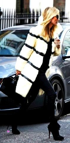 kate Moss in white fur and leather.