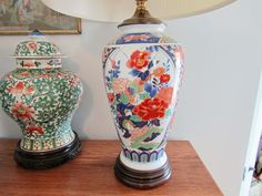 """Asian lamps and decorative items including a pair of 24""""T porcelain decorator lamps, 12""""T lidded urn on a teak stand"""