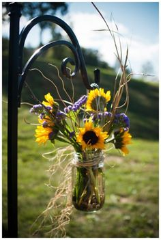 sunflower and mason jar aisle decor