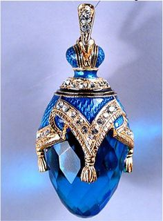 Beautiful blue glass perfume bottle with jewels
