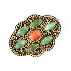Jade and coral brooch. want it.