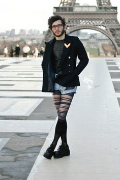 Mostly a unisex outfit, but with one accessory that could be considered feminine, the tights.