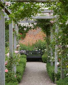 to Steal: 10 Ways English Gardens Borrow from France - Gardenista A rustic pergola decorated with roses and boxwood.A rustic pergola decorated with roses and boxwood.