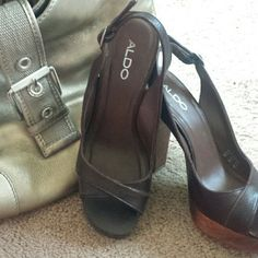 Aldo Brown Leather and Wood Slingbacks Size 9 Good Condition Aldo Brown Leather Slingbacks. Wood and platform heel. Worn a few times. Tread on bottom in great condition. Slight wear on inside of shoe. Not visible when wearing at all. These are my FAV shoes but need foot surgery. Make an offer! ALDO Shoes Sandals
