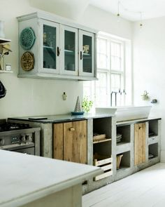 Contemporary rustic kitchen. Wood and concrete kitchen bench/cupboards.
