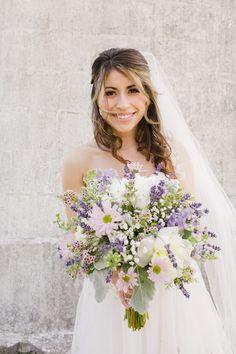 purple bouquet, photo by Daphne and Dean http://ruffledblog.com/lighthouse-point-park-wedding #weddingbouquet #flowers