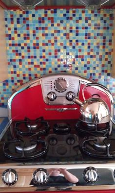 Cute Kitchen w/ retro red stove. Backsplash is a custom Brio glass mosaic tile blend. www.modwalls.com Cute Kitchen, Red Kitchen, Kitchen Ideas, Kitchen Design, Vintage Stoves, Retro Stoves, Contemporary Tile, Stove Backsplash, Backsplash Ideas
