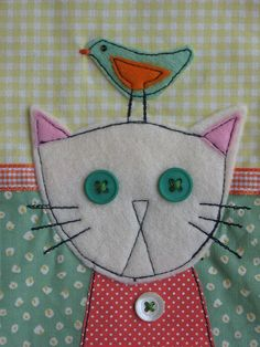 Close-up cat and bird applique   xx