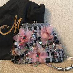 """Mary Frances handbag Very whimsical bag. Black and gray background with pink organza flower accents and intricate floral motif beading. Gently used but in very good condition. Strap can be tucked in to use as a clutch or not and used as a shoulder bag. 14"""" drop. Mary Frances Bags Shoulder Bags"""