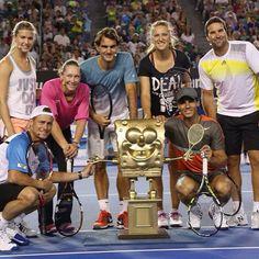 Tennis stars including Roger Federer gather around a SpongeBob trophy