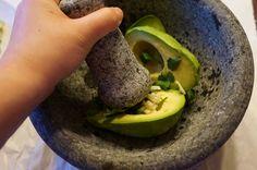 guacamole made using a granite mortar and pestle. festive!