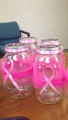 Donation collection jars for Breast cancer awareness in pink or purple for Relay.