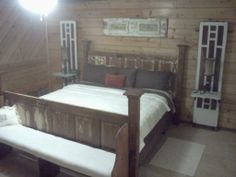 my bedroom, old doors for headboard and footboard, sidelights for lamp shelf, bench made by gary, old shutter above my bed.