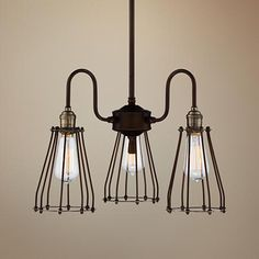 """Avenel Industrial Edison 19"""" Wide Bronze 3-Light Pendant $129.95 Avenal industrial style 3-light pendant. Oil-rubbed bronze finish. Antique brass accents. From Franklin Iron Works. Includes three 60 watt vintage style Edison bulbs. Measures 19"""" wide, 17 3/4"""" high. Includes one 6"""" and three 12"""" downrods. Maximum hanging height is 54 3/4"""". Metal cage shade is 3 1/4"""" across the top, 5 1/2"""" across the bottom, 7 1/2"""" high. Canopy is 5 1/2"""" wide, 3/4"""" high. Hanging weight is 5.5 lbs"""