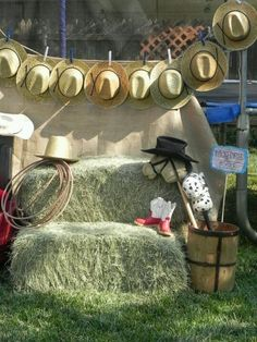 Photography backdrop for Lil Buckeroo Beauty Birthday Party. Burlap background, western hats closed pinned on jute, hay bales ( I threw an old quilt over one of the bales), stick horses. The kids played with it all after pictures were taken.