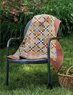 This Apple Cider quilt by Jo Morton is based on an antique. You need only two colors per Nine Patch block: one light and one dark.