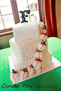 Classic wedding cake decorated with chocolate covered strawberries that look like baseballs!