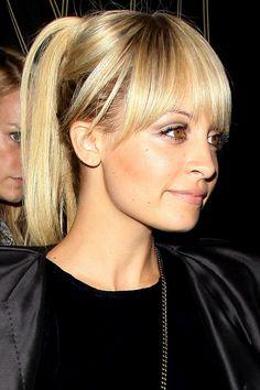 Nicole Richie's full fringe and glossy up-do
