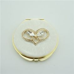 Butterfly series crystal makeup mirror/Small pocket mirror It is covered with ivory enamel glaze and mounted with bling-bling crystals.