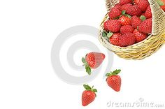 Strawberry falls from a wicker basket with berries