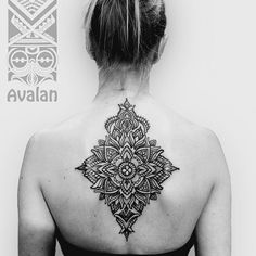 Mandala back tattoo for women - A rare diamond shaped black mandala tattoo. Even though most mandala tattoos are in circle shape, there are also those with diamond shapes if it fits the details and the meaning behind it.