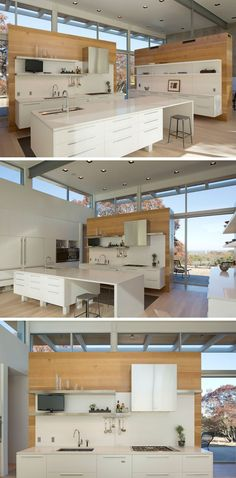 In this modern kitchen a combination of white cabinets and island, stainless steel shelves, appliances, and hardware, and wood walls give the space a bright natural look and help keep the home feeling open and connected. Open shelving, double sinks, plenty of storage, and lots of prep space also make this kitchen extremely functional and perfect for entertaining.