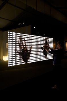 'You Fade To Light' is is an interactive media installation that provokes a kinesthetic dialogue between the viewer and their very own mirror image. The work encourages the audience to physically and intuitively experience the creation of light itself.