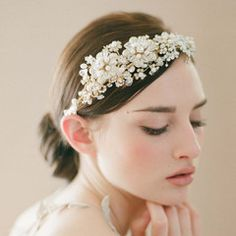 An amazing headpiece of crystals and faux golden flowers will make any bride feel regal on her wedding day.