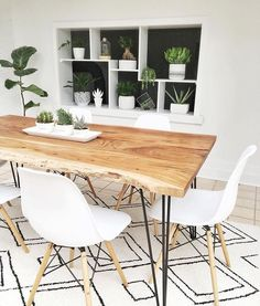 I LOVE this pairing! Beautiful, crisp Eames Dowel Leg Side Chairs around an organic, live edge dining table. Shop Eames at SmartFurniture.com