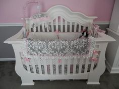 Elegant white pink and gray damask baby crib bedding set for a girl's princess theme nursery room: The pretty pink and gray princess nursery that we decorated for our baby girl nursery is a room that can grow with our baby from infancy through the toddler