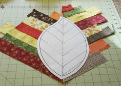 Buttons and Butterflies: Quilted Leaf Potholders {Tutorial} this technique would be lovely for appliques on a quilt