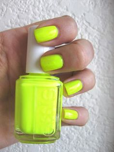Essie neon yellow nails.
