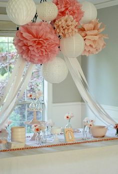 white and pink lanterns and poms
