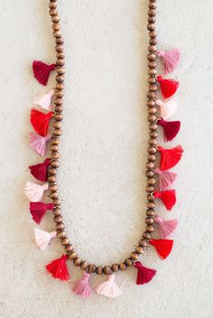 We are all about the tassels ladies. There's something so fun and flirty about this necklace that features soft and romantic colors--red, burgundy, and pink are the compliment to any outfit. Chocolate