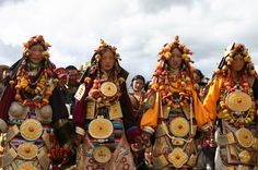 Yading women's traditional ceremonial / wedding dresses with big religious amulets and lots of jewellery